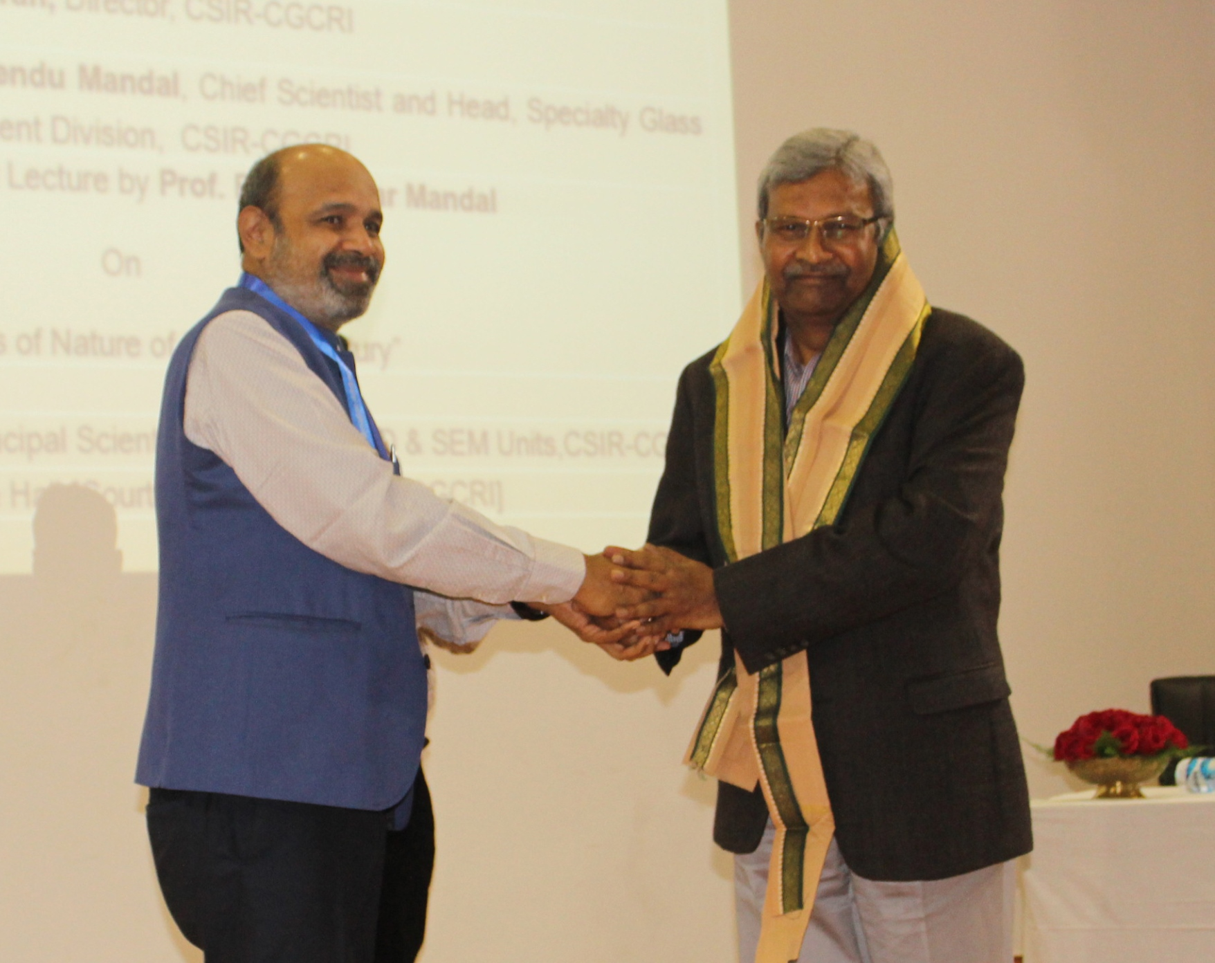 Director presenting uttariya to Prof Rajiv Kumar Mandal during NSD 2020